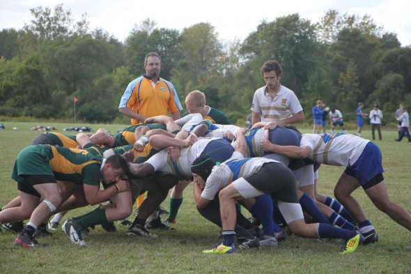 Members of the Hamilton College and Oswego State men's rugby scrum packs battle for possession during Saturday's match, won by the Wizards.  (Photo provided by Reid Adler)