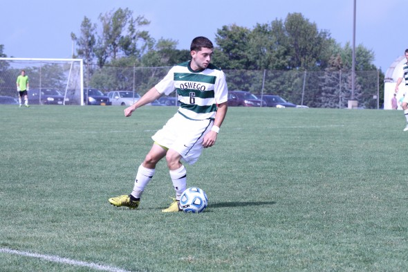 Lakers' senior captain Zach Saccocio controls the ball in a game during the Oswego State Men's Soccer Tournament at Laker Field last weekend.  (Photo provided by Sports Information)