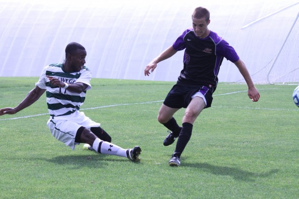 Freshman Shaka Ballentyne hits the ground in a game during the Oswego State men's soccer tournament against the Alfred University Saxons.  (Photo provided by Sports Information)