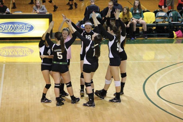 Members of the Oswego State volleyball team come together in celebration after a successful point in the Oswego State Tournament last weekend.  (David Armelino | The Oswegonian)