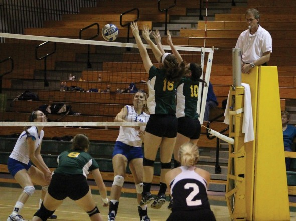 Freshmen Megan Russell and Lindsey Champitto, members of the Lakers front row, finish a successful block during the Oswego State Fall Classic.  (David Armelino | The Oswegonian)