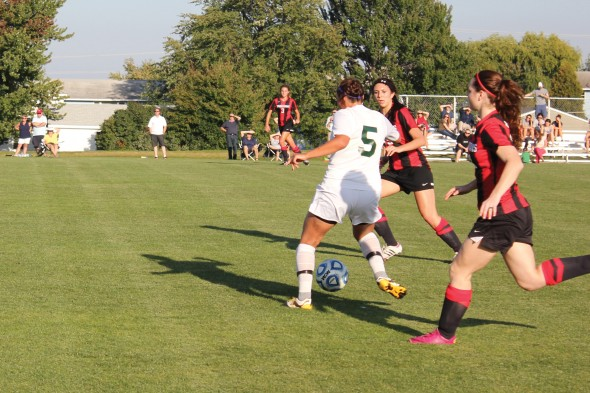 Senior forward Nikki Liadka winds back to pass the ball upfield during Oswego State's 1-0 victory over D'Youville College on Friday afternoon.  (Perry Kennedy   The Oswegonian)