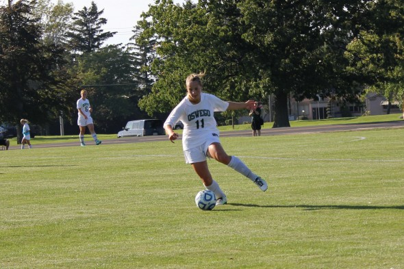 Sophomore Bailey Waterbury picks up the ball just outside the Oswego State goalie box and begins upfield during the Lakers contest Friday against D'Youville.  (Perry Kennedy   The Oswegonian)