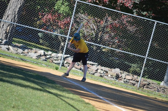 A student looks at a pitch in the dirt during a campus recreation softball game. WTOP and Athletes is the lone undefeated team in the co-rec competitive division.  (Photo provided by Campus Recreation)