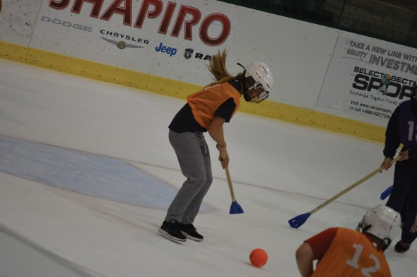 A student tries to control the ball during an intramural broomball game at the Campus Center Ice Arena.  (Photo provided by Allison Martin)