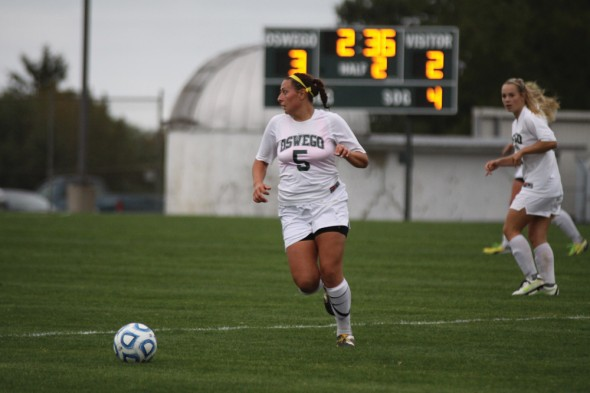 Senior captain Nikki Liadka (left) is a key to Oswego State's success in 2013 with her team-lead in goals, shots and points with 10, 40 and 20, respectively.  (Photo provided by Sports Information)