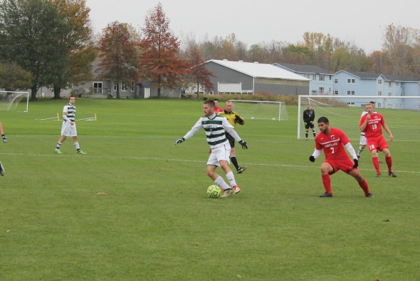 Oswego State senior midfielder Ryan Tibbetts controls the ball for the Lakers. The team finished the 2013 season with a 0-10-5 (0-5-4 SUNYAC) record.  (Perry Kennedy | The Oswegonian)