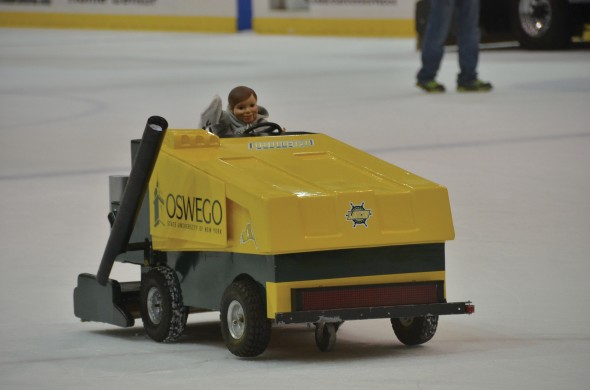 Team Mini's miniature Zamboni is operated by students on the Campus Center Ice Rink to help electrify the crowds and launch T-shirts at them.  (Seamus Lyman | The Oswegonian)