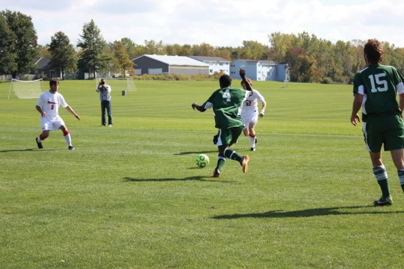 Freshman Paul Kwoyelo approaches the ball during Oswego State's match Saturday afternoon against Oneonta State. The Lakers fell to the Red Dragons, 4-0.  (Perry Kennedy | The Oswegonian)