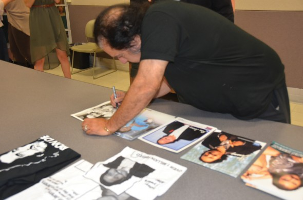 Ron Jeremy signs autographs for students during a meet and greet session after his debate with Susan Cole.  (Ronel Puello | The Oswegonian)