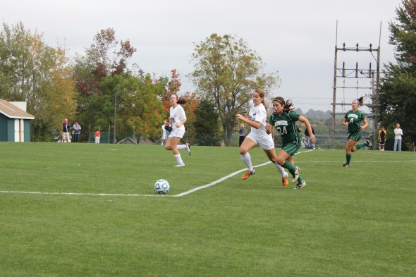 Junior Bri Dolan (9) battles for possession of the ball during Oswego State's match against Potsdam.  (Perry Kennedy | The Oswegonian)