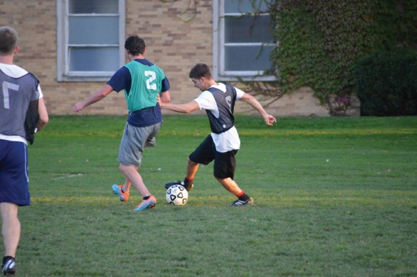 A player charges upfield during an intramural soccer match on the field outside of Lee Hall this past week.  (Photo provided by Allison Martin)