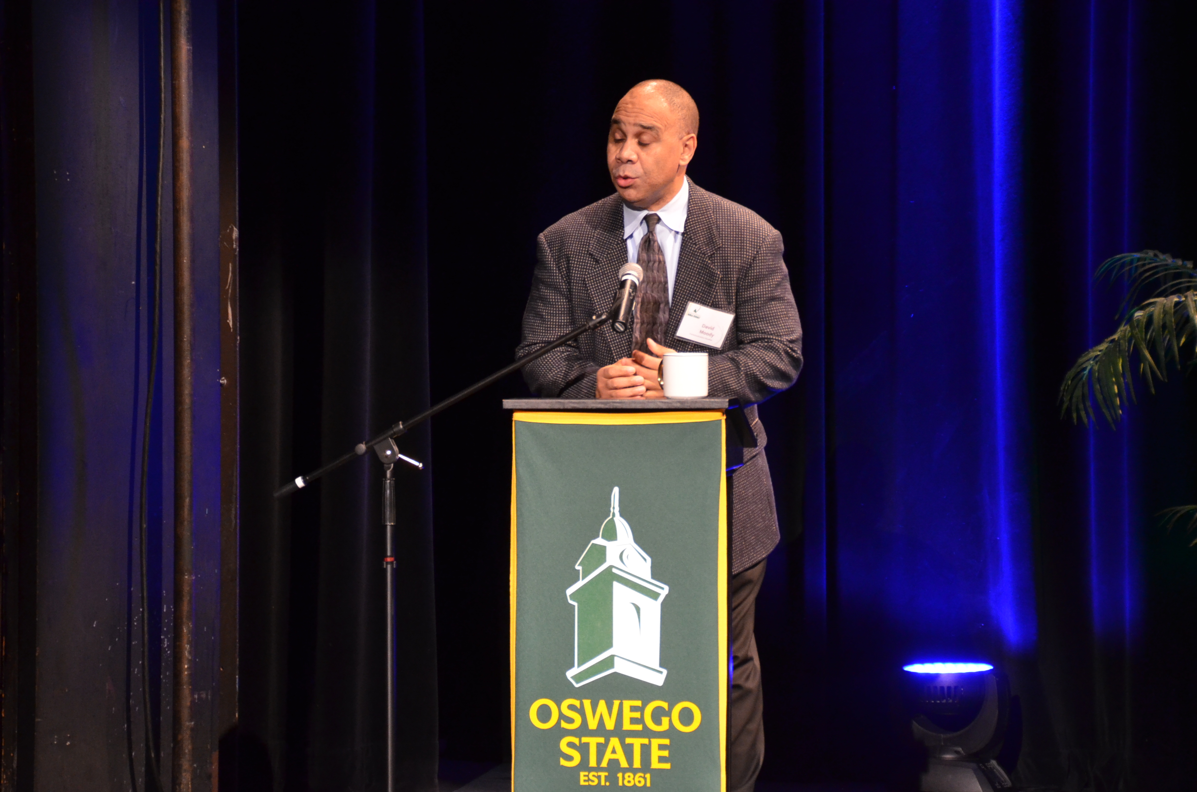 Dr. David Moody greets audience before the panel discussion. (Patrick Malowski | The Oswegonian)