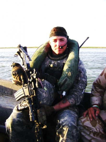 Ken Cisson on a boat in Basra, Iraq where he went on over 300 missions.  (Photo provided by Ken Cisson)