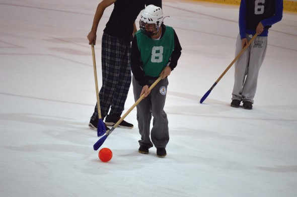 A student controls the ball during an intramural broomball game at the Campus Center Ice Arena.  (Photo provided by Allison Martin)