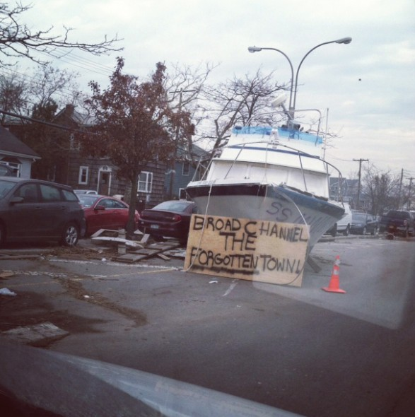 A boat rests in the middle of the road after the powerful hurricane made landfall at Broad Channel, Queens in New York City. $65 billion in damage was reported.  (Photo provided by Bailey Smith)