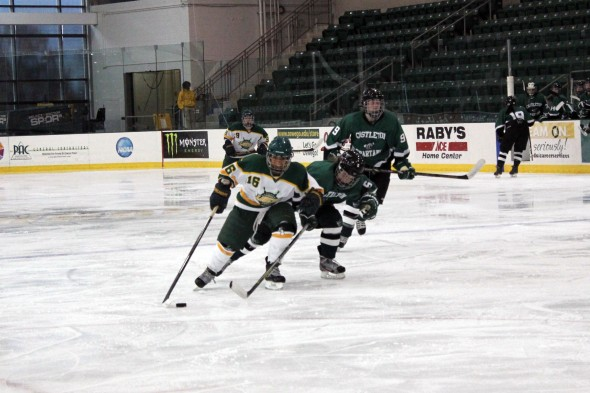 Senior forward Melissa Seamont holds off an oncoming Castleton player as she enters the offensive zone on Sunday afternoon. Oswego State won 3-2 in overtime.  (Perry Kennedy | The Oswegonian)