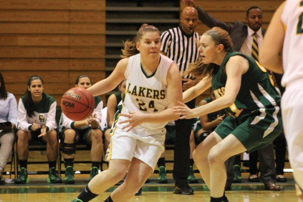 Senior guard Lauren Nunziato looks to drive past a defender during the Oswego State women's basketball team's 76-60 win in the Max Ziel Tournament.  (David Armelino | The Oswegonian)
