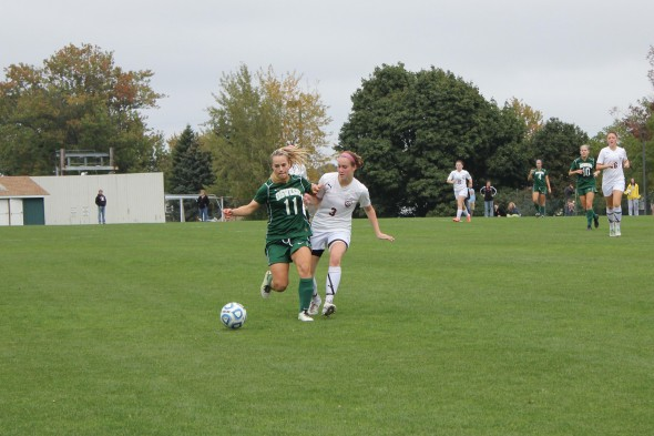 Sophomore Bailey Waterbury fights for the ball during Oswego State's match against Potsdam. The Lakers finished the season 10-7 and clinched a playoff spot.  (Perry Kennedy | The Oswegonian)