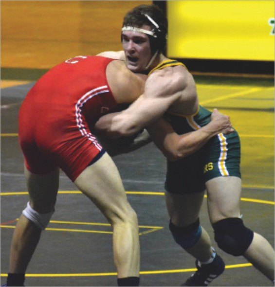 Junior captain Scott Bova battles for positioning with a SUNY Cortland wrestler. Bova lost his match in a close 6-5 decision.  (Seamus Lyman | The Oswegonian)