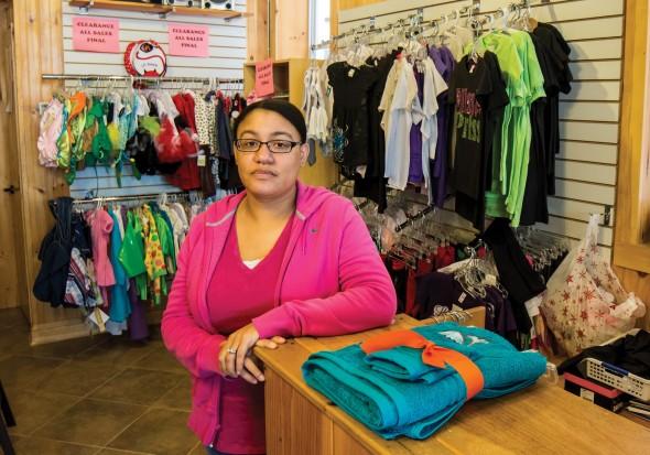 Danielle Pederson, owner of the Polka Dot Monkey in Oswego, poses in her store.  (Moraima Capellán Pichardo   The Oswegonian)