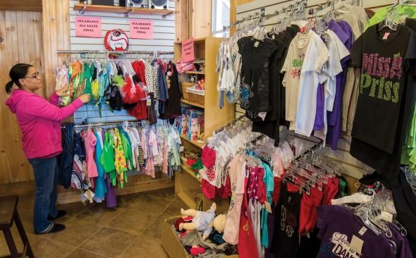 Danielle Pederson checking stock at The Polka Dot Monkey, her store.  (Moraima Capellán Pichardo   The Oswegonian)