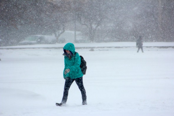 Students are walking to class in the wet snow and frigid temperatures. (David Armelino | The Oswegonian)