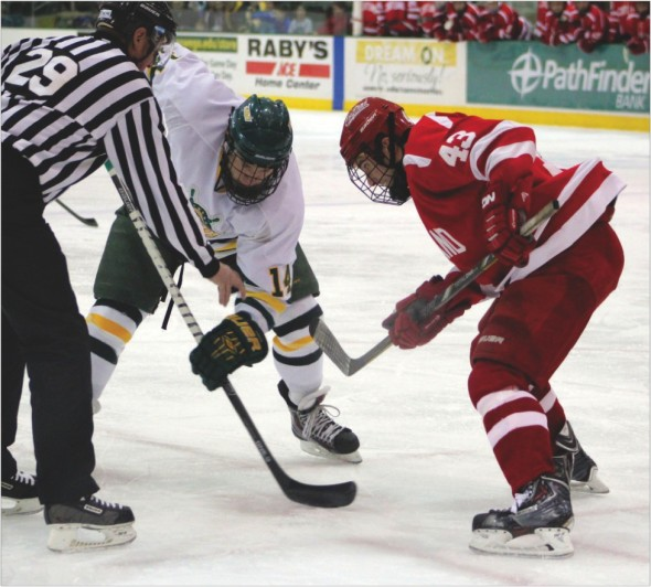 Sophomore Brandon Adams prepares for a faceoff during the Lakers showdown with Cortland last Saturday night.  Adams scored the final goal in the 4-2 win.  (David Armelino | The Oswegonian)