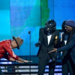 Grammy ceremony dazzles with genre-bending duets, upsets