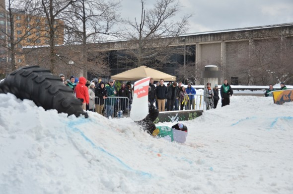 A participant in the rail jam falls attempting a trick.  (Connor Gannon | The Oswegonian)