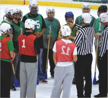 Students gather around the referees before a broomball game at the Campus Center Ice Arena.  (Photo provided by Campus Recreation)