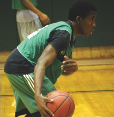 A student controls the ball and ponders his next move during a campus recreational basketball game.  (Photo provided by Campus Recreation)