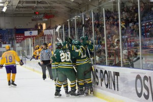 The Lakers celebrate after freshman Shawn Hulshof put home their lone goal of the evening during Friday night's NCAA semifinal matchup with Wisconsin-Stevens Point (Justin Dobrow | The Oswegonian).