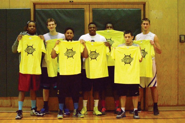 Members of Lee Hall Legends pose with the co-rec intramural basketball championship T-shirts in Lee Hall.  (Photo provided by Campus Recreation)