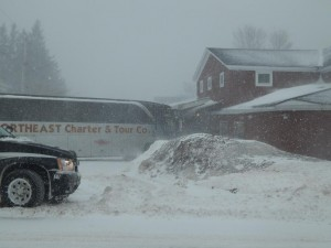 The charter bus carrying the Bowdoin men's hockey team slid off W. Utica and into the awning of Canales Restaurant on 71 W. Utica St.
