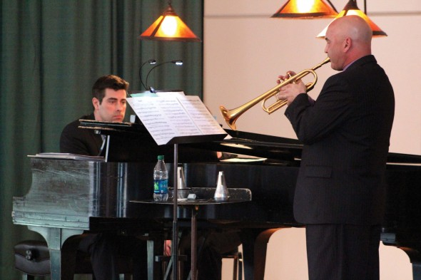 Faculty pianist Rob Auler and trumpeter Terry Caviness collaborated on a three-piece musical revue that transcended genres and decades.  (David Armelino | The Oswegonian)