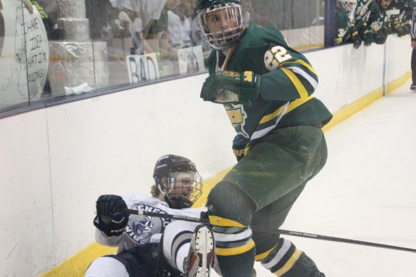 Mac Scott knocks down a Geneseo skater. (David Deffenbaugh | The Oswegonian)