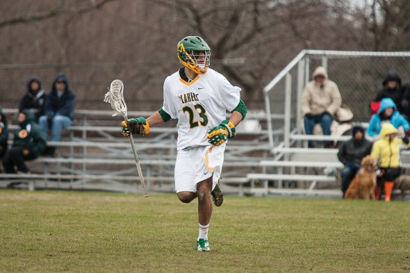 Junior Matt Palmer controls the ball during a men's lacrosse game. Oswego State is 1-1 to start the season. (Photo provided by Sports Information)