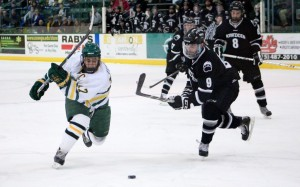 Captain David Titanic makes a move toward the Bowdoin goal (David Armelino | The Oswegonian)