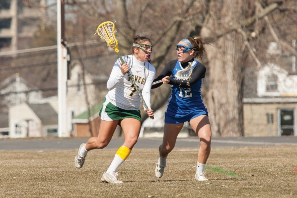 Senior Kaila Curatalo advances the ball for the Lakers,  who opened the season with a 10-6 win at Utica College. The team finished the 2013 season with an 8-8 record. (Photo provided by Sports Information)