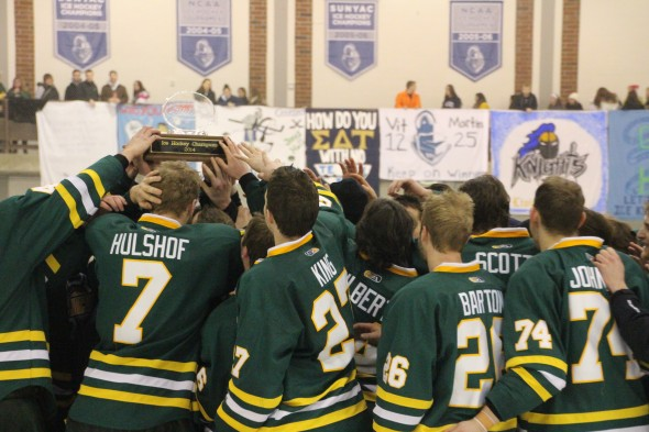 The Lakers celebrate the SUNYAC championship. (David Deffenbaugh)