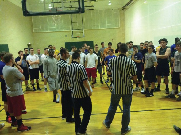 Oswego State students gather on the basketball court in Swetman Gymnaisum for the 3-0n-3 basketball tournament. Easy 1st Round won the championship.  (Photo provided by Campus Recreation)