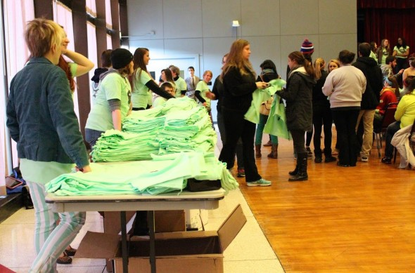 T-shirts being handed out to students who came to the event, designed to combat society's view of women.  (David Armelino | The Oswegonian)