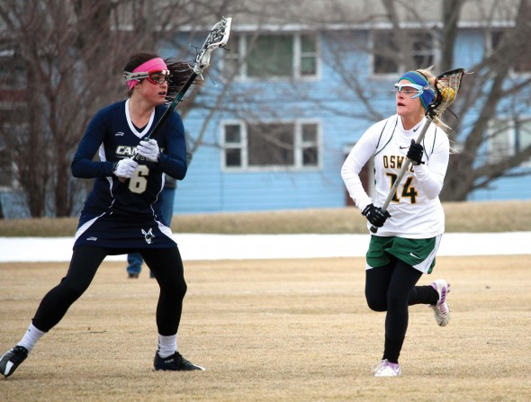 Senior Mackenzie Kjerstad (right) looks to advance the ball and evade a SUNY Canton defender during Oswego State's 9-8 home win over the Kangaroos.  (David Armelino | The Oswegonian)