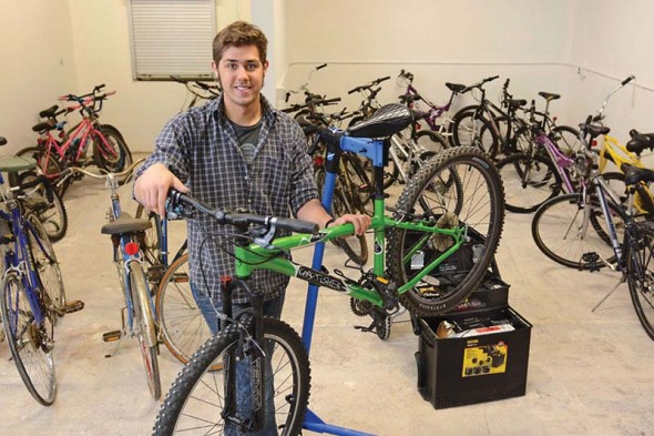 Alex Elkins founded the bike sharing program at Oswego State, housed in the basement of Hewitt Union.  (Photo provided by Public Affairs)