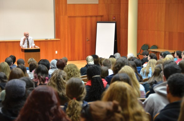 Students listen to Bruce Coville in the Campus Center Auditorium on Quest day. Coville was the keynote speaker for the day-long symposium.   (Andrew Pugliese | The Oswegonian)