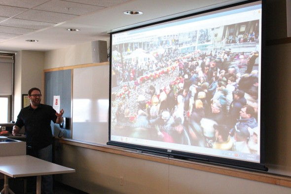 """Zach Roberts presents """"Eye of the Ukrainian Storm"""" on the ongoing conflict in Ukraine. He was sponsored by Cristina Dragomir of the political science department.  (David Armelino 