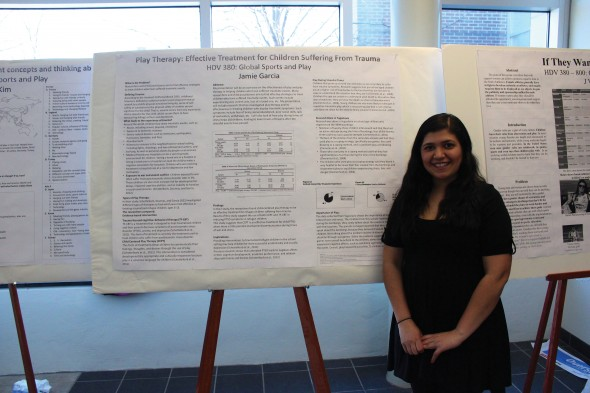 """Jamie Garcia presented her poster titled """"Play Therapy: Effective Treatment for Children Suffering from Trauma"""" from HDV 380: Global Sports and Play.  (David Armelino 