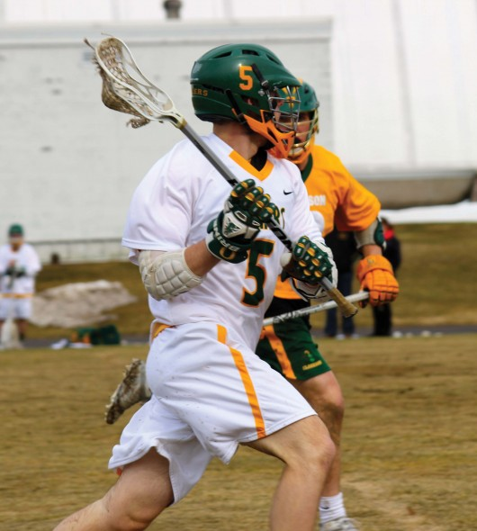 Junior Kyle Wistner looks to advance the ball during Oswego State's 11-9 loss against Clarkson University.  (Maximilian E. Principe)
