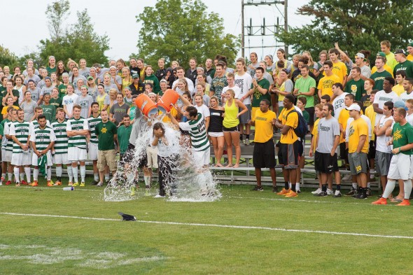Men's soccer players dump ice water on Vice President Woolfolk as part of the ALS Ice Bucket Challenge.  (Photo provided by Sports Information)